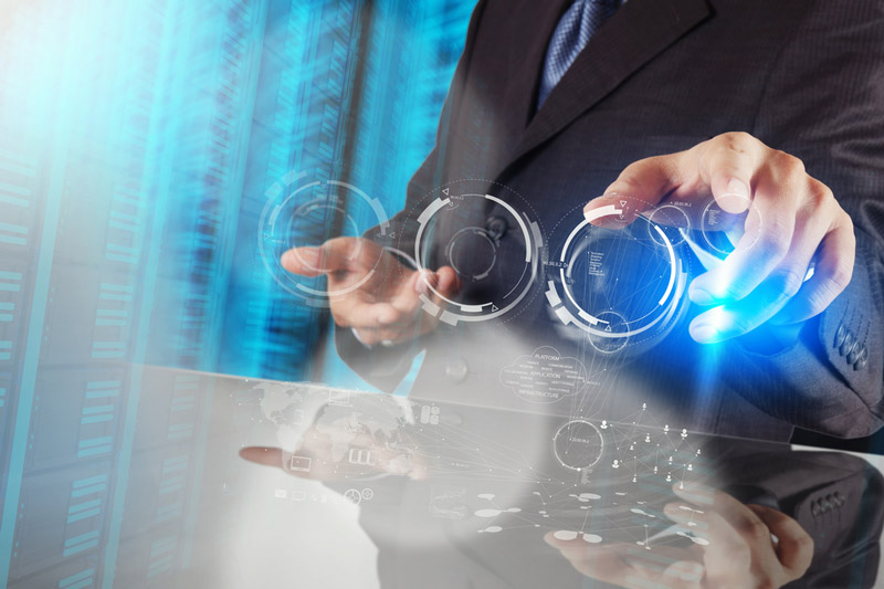 a man in a suit with futuristic rings in his hands