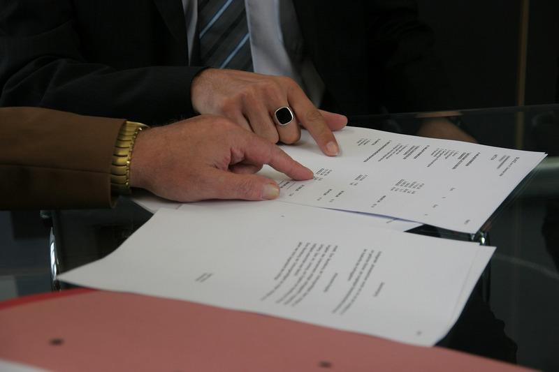 Vendors sign a contract