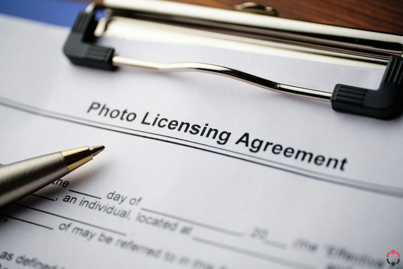 Legal document Photo Licensing Agreement on paper close up