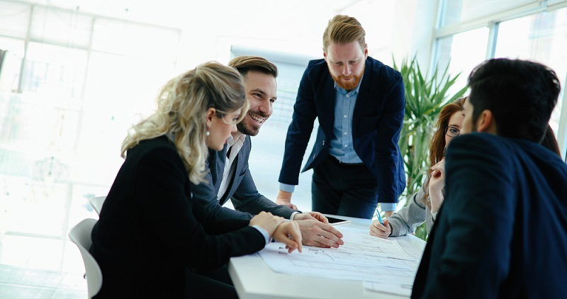 Group of people working together on contract
