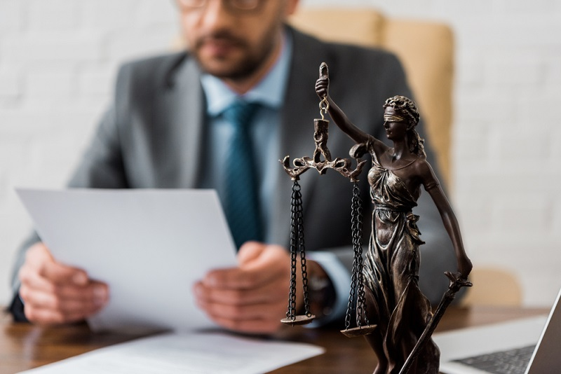 a legal officer reads a document