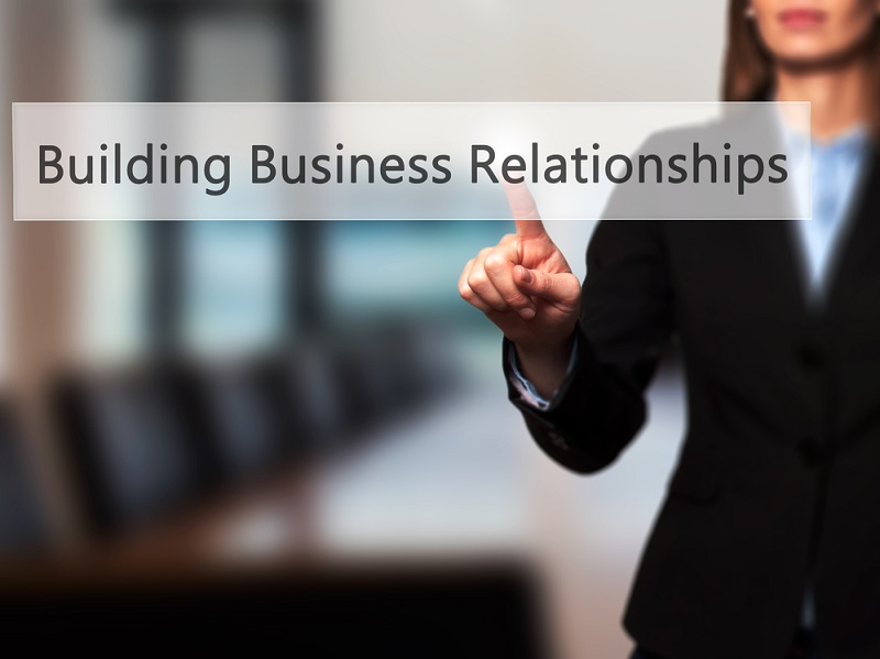 woman points to business relationship