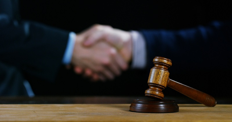 in-house legal lead shakes hands