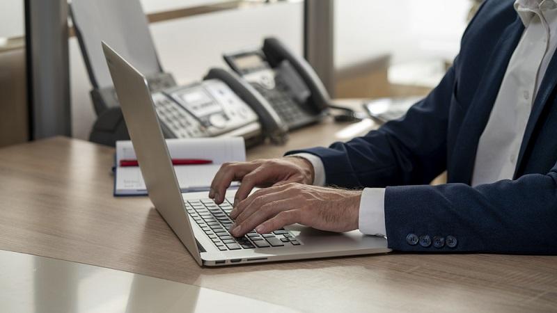 businesman makes contract online