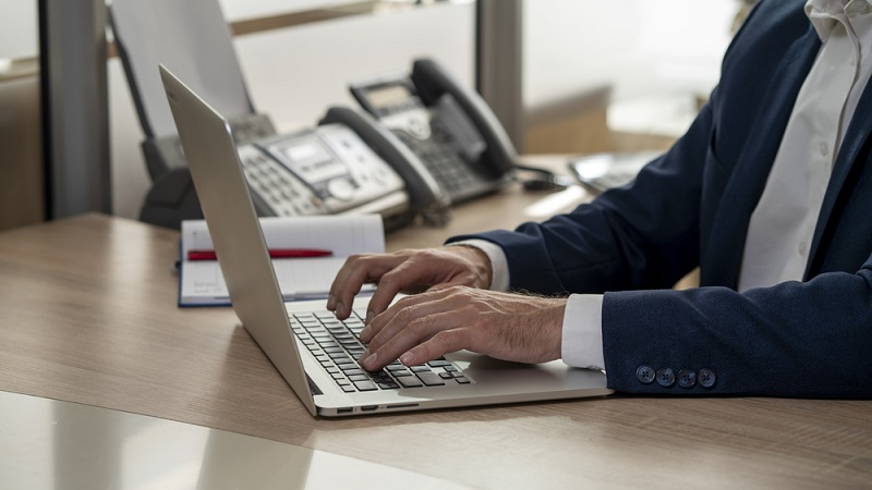 a man manages a contract with modern contract management platform