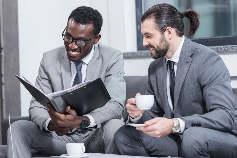 two businessmen identifying revenue opportunities
