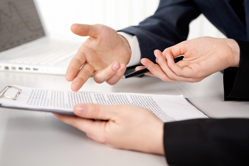 Two Men Reviewing Contract