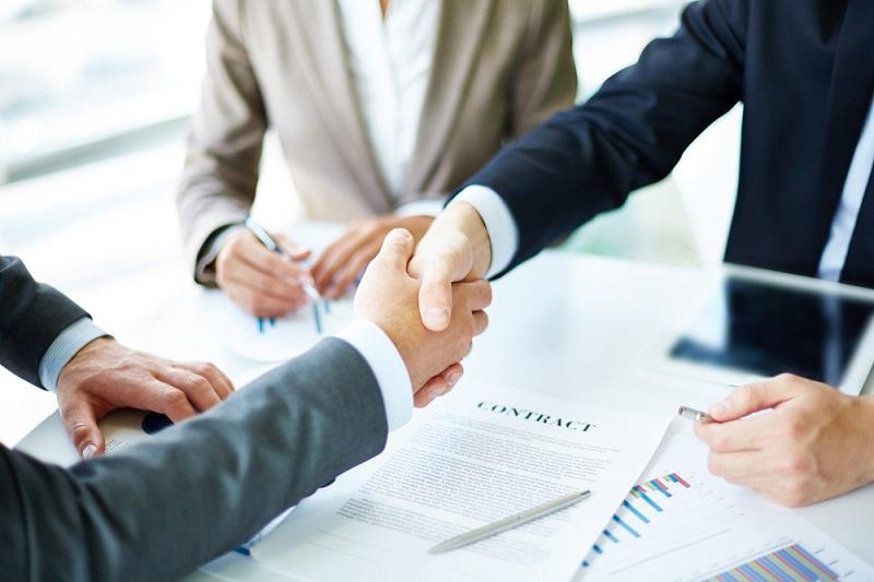 business partners handshaking over new contract