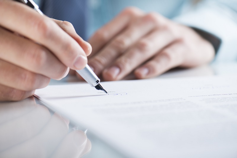 signing a contract on paper